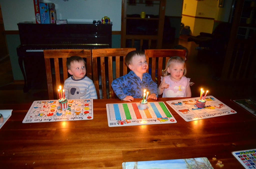Triplets with birthday candles
