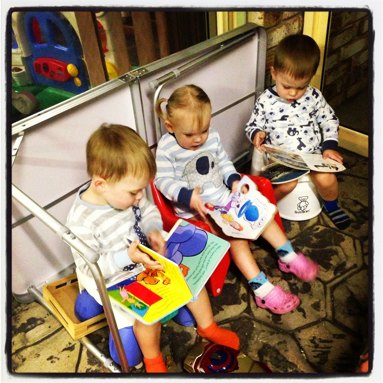Triplets sitting on potty