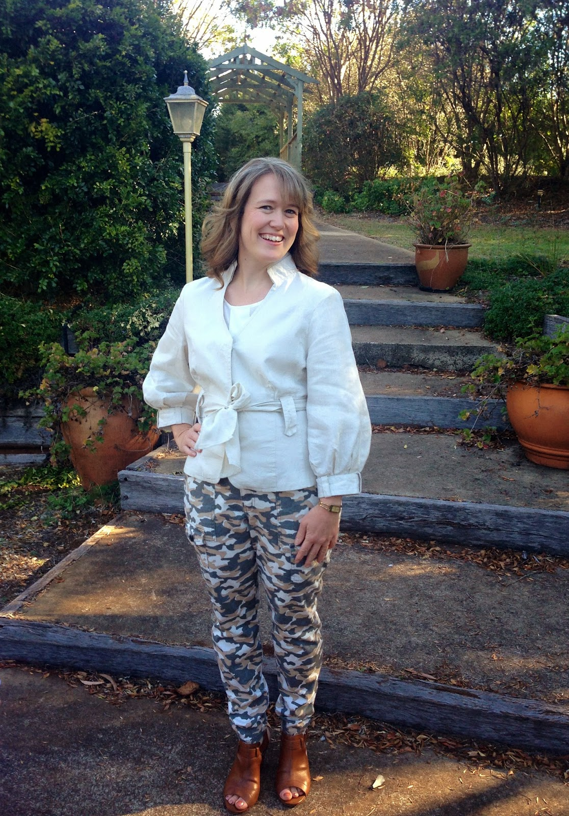 Styling skinny camo jeans with a jacket