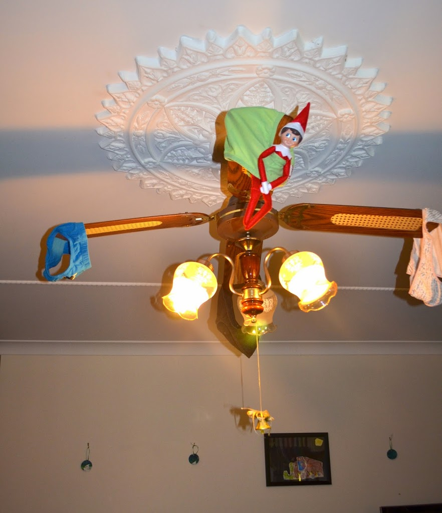 Elf on the shelf on a ceiling fan